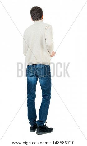 Back view of man . Standing young guy. Rear view people collection.  backside view of person.  Isolated over white background. Curly short-haired man in a woolen white jacket thoughtfully looking