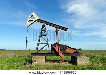 Pump Jack in a open green field