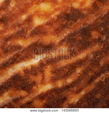 Close-up texture of a cheesecake crust as a background composition