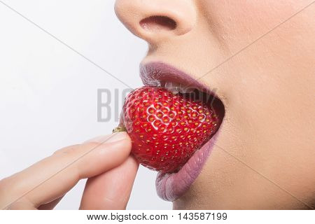 Female Lips Eating Red Strawberry