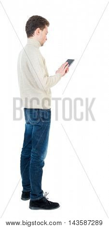 back view of business man uses mobile phone.    rear view people collection. Isolated over white background. backside view of person. Curly short-haired man in a woolen white jacket standing sideways