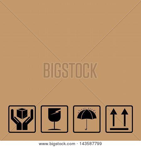 Black fragile symbol on brown cardboard background.