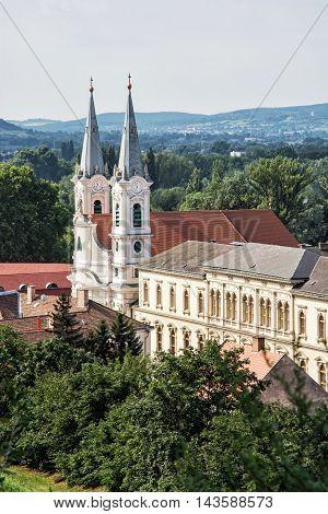 Saint Ignatius church view from Esztergom basilica Hungary. Travel destination. Cultural heritage. Urban scene. Religious architecture. Danube river. Vertical composition.