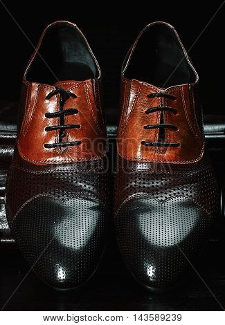 New polished leather brown shoes over black