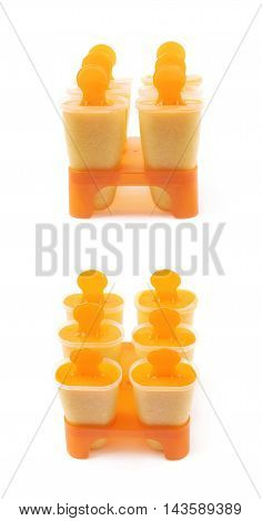 Plastic orange popsicle ice lolly form molds set isolated over the white background, set of two different foreshortenings