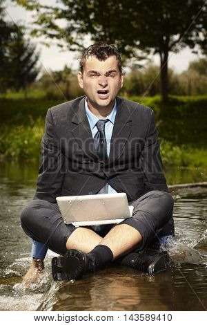 Tired crazy businessman in suit after burning out