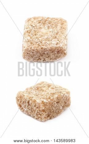 Single brown sugar cube isolated over the white background, set of two different foreshortenings