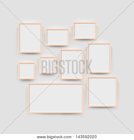 Wood blank frame wall gallery set for photographs. Vector picture frame mockup template on wall background
