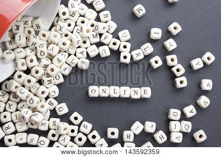 Online word written on wood block. Wooden ABC