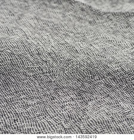 Gray cloth fabric close-up fragment with a shallow depth of field as a backdrop composition