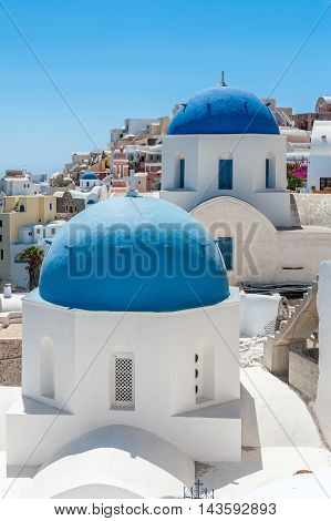 White and blue view of Santorini with two domes - Greece