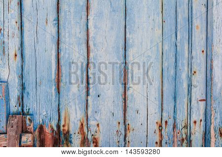 Texture of Wood panel painted of blue - background