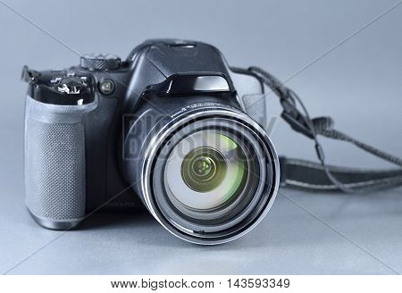 Digital camera, studio shot of photography equipment, bridge camera.