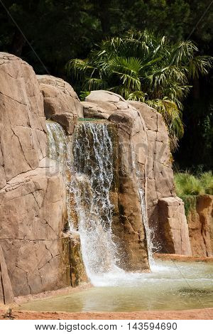 Waterfall in a park at summer time