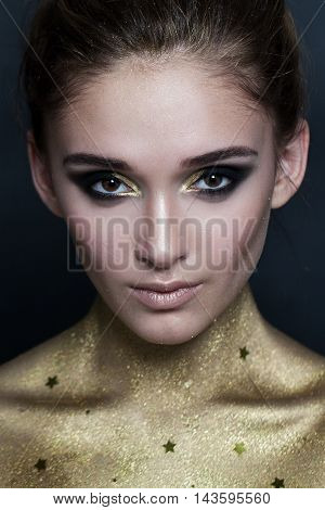 beautiful Fashion Model. Makeup and Golden Skin