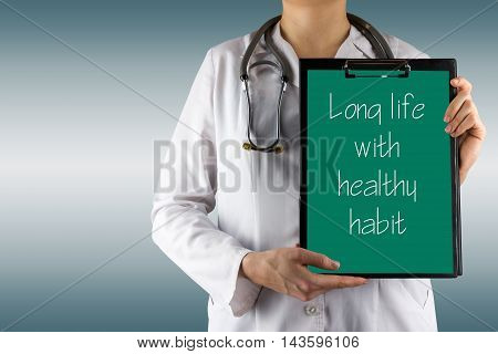 Female doctor's hand holding medical clipboard and stethoscope. Concept of Healthcare And Medicine. Copy space.