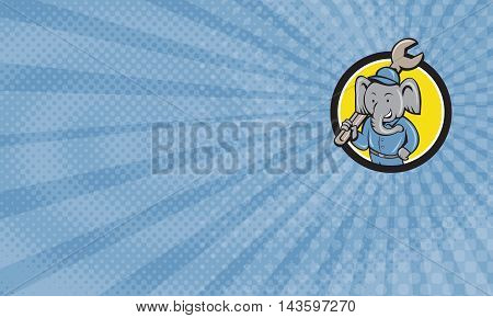 Business card showing Illustration of an elephant mechanic holding spanner on shoulder viewed from front set inside circle on isolated background done in cartoon style.