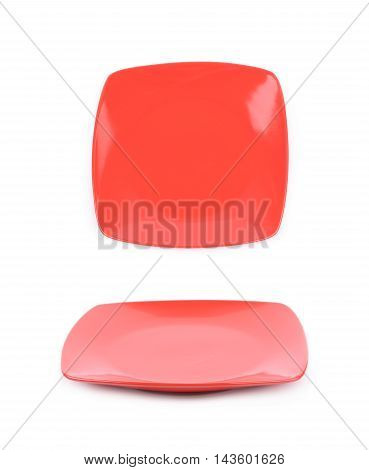Square red empty ceramic plate isolated over the white background, set of two different foreshortenings