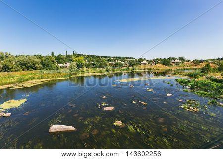 top view of the overgrown river Ukrainian landscape Ukrainian village.