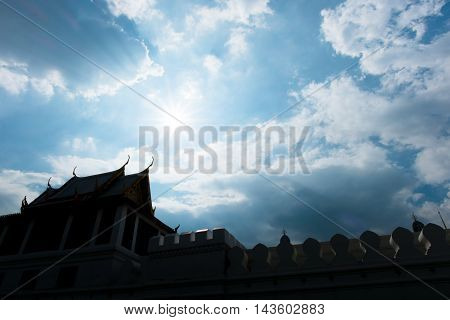 Silhouette Photo Of Thai Fortress With Sun Beam Over Rooftop With Sky And Cloud