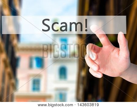Scam! - Hand Pressing A Button On Blurred Background Concept On Visual Screen.