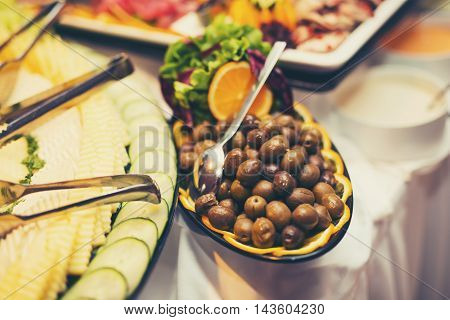 Plate green olive on the buffet table