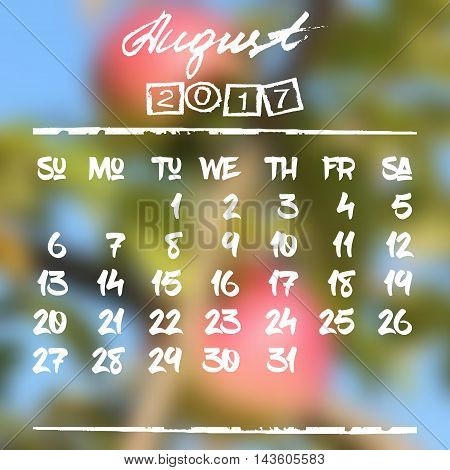 Calendar design grid in hand written style with white lettering and dates of summer month August 2017 on natural blurred background. Blurry red apples. Vector illustration
