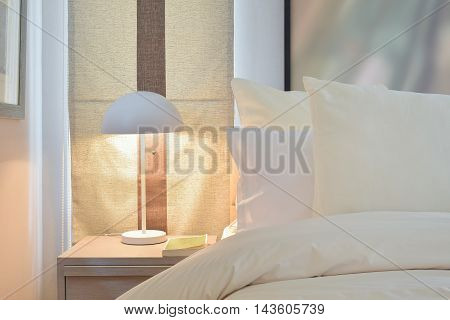 Reading lamp on bedside table at home