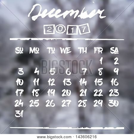 Calendar design grid in hand written style with white lettering and dates of winter month December 2017 on natural blurred background. Fir trees in snow. Vector illustration
