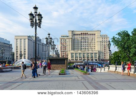 MOSCOW RUSSIA - JULY 23 2016: Unidentified people walk on Manezhnaya Square near Four Seasons Hotel Moscow 5 * (previously - hotel