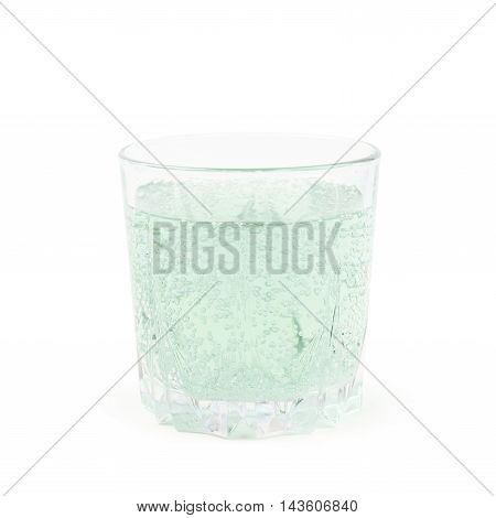 Rocks old fashioned glass filled with the carbonated green lemonade water isolated over the white background