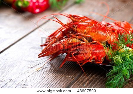 Crayfish. Red boiled crawfish on a wooden table in rustic style, close-up, selective focus. Lobster closeup