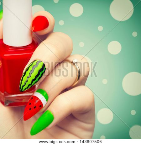 Nail art manicure. Watermelon style bright summer Art Manicure for long nails. Nail Polish. Beauty hands. Trendy Stylish Colorful Nails and Nailpolish