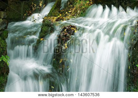 beautiful waterfalls with autumn leaves after fulling