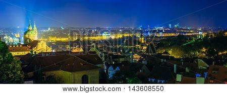 Night panoramic view of Prague, Czech Republic. Night view of St. Nicholas Church