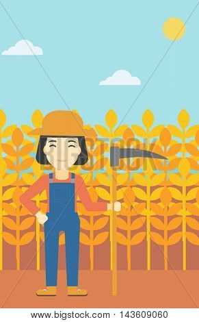 An asian female farmer holding a scythe. Young farmer standing on the background of wheat field. Vector flat design illustration. Vertical layout.