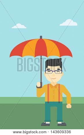 An asian businessman standing with open umbrella on the background of blue sky. Businessman under open umbrella. Happy man with umbrella. Vector flat design illustration. Vertical layout.