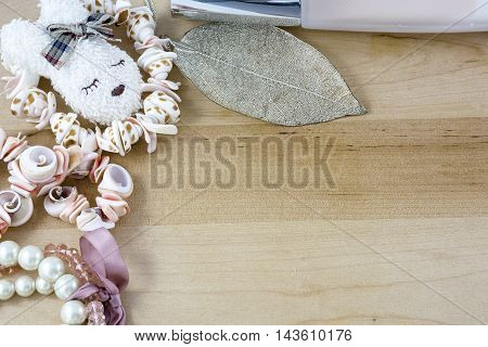 Girl's pink bijouterie on light wooden background