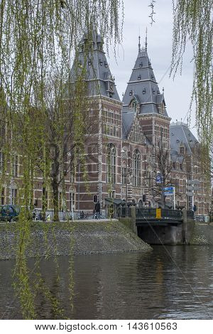 Historical building with museum near the canal in Amsterdam