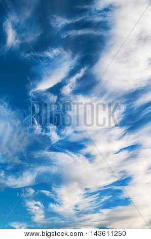 Dramatic sky. Sky landscape of cloudy sunset sky. Blue sky background with white sky clouds lit by sunny light in good weather- natural sky background. Picturesque clouds in the sky lit by sunlight