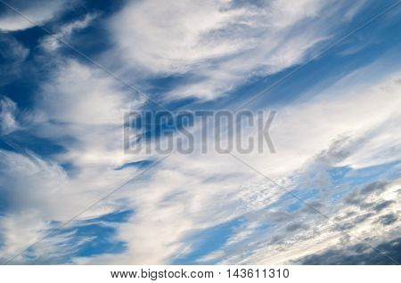 Sky.Dramatic sunset sky. Sky landscape of cloudy sunset sky. Blue sky background with white clouds lit by sunlight in good weather-natural sky background. Picturesque clouds in the sky lit by sunlight
