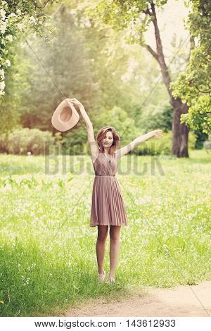 Carefree Woman Outdoors. Health andCarefree Woman Outdoors. Health and Freedom Freedom