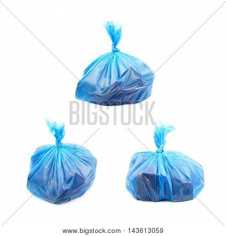 Filled blue plastic garbage bag isolated over the white background, set of three different foreshortenings