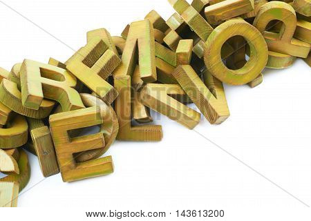 Pile of painted block wooden letters isolated over the white background, close-up crop framgent composition