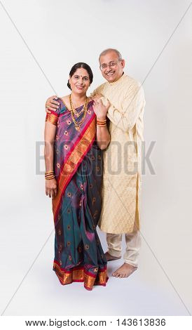 Portrait of a happy elderly Indian or maharashtrian couple in traditional clothing