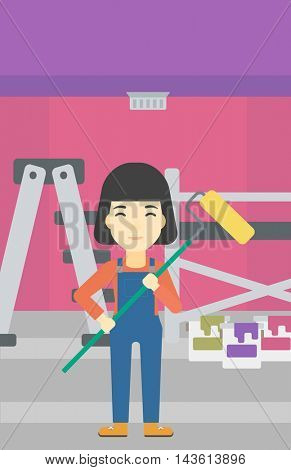 An asian female painter in uniform with a paint roller in hands. Painter at work in an apartment with paint cans and ladder. Vector flat design illustration. Vertical layout.