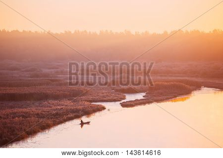 Calm Lake, River And Rowing Fishing Boat At Beautiful Sunrise In Autumn Morning. Fisherman Is In Boat