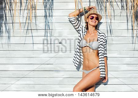 Sexy Woman In Bathing Suit Standing In Sunlight