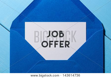 Job offer in blue envelope. Hiring and employment concept background.