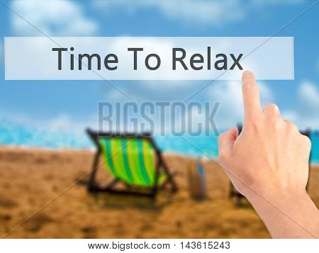 Time To Relax - Hand Pressing A Button On Blurred Background Concept On Visual Screen.